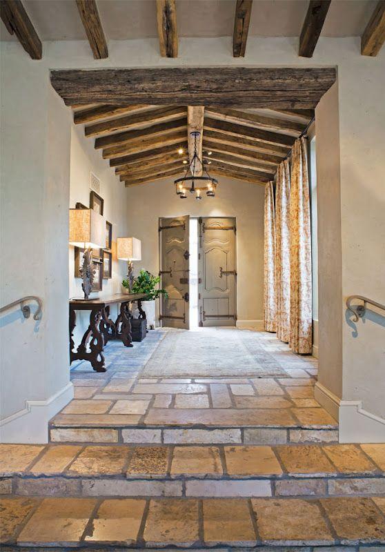 Tile floors & wood beams with plaster walls.