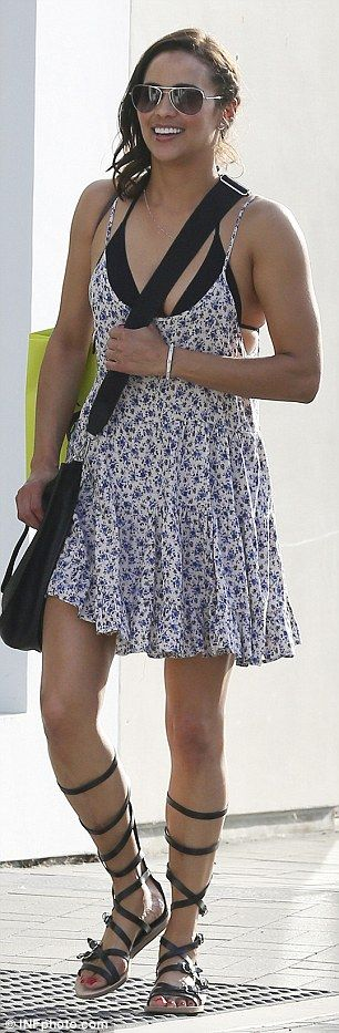 Flower power! The 39-year-old actressdisplayed cleavage in the floral frock, which she wore over a black bikini