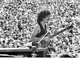 Carlos Santana with crowds at Woodstock 1969 by David Marks