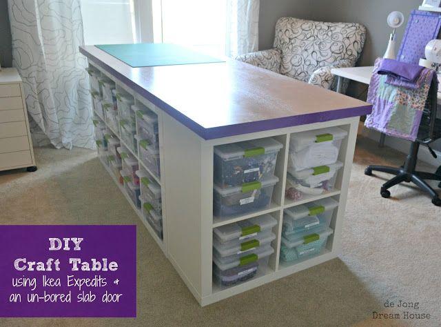 de Jong Dream House: DIY Craft Table using Ikea Expedits, un-bored slab door, and Sterilite clip boxes.