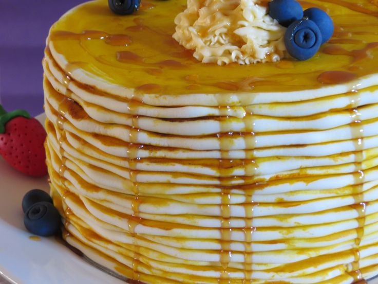 Pancake Cake with suspended maple syrup bottle. Layers of Vanilla cake, Wild Blueberry jam and Maple syrup infused buttercream.