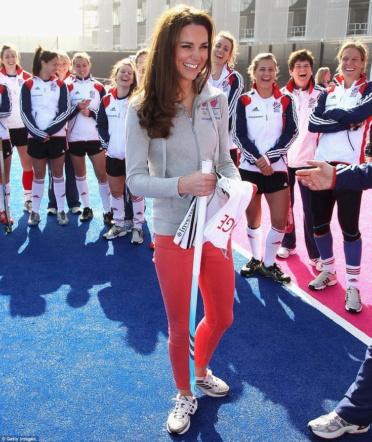 Kate joins in playing with the British Olympic Team as she visits them in the Olympic Park in Stratford.