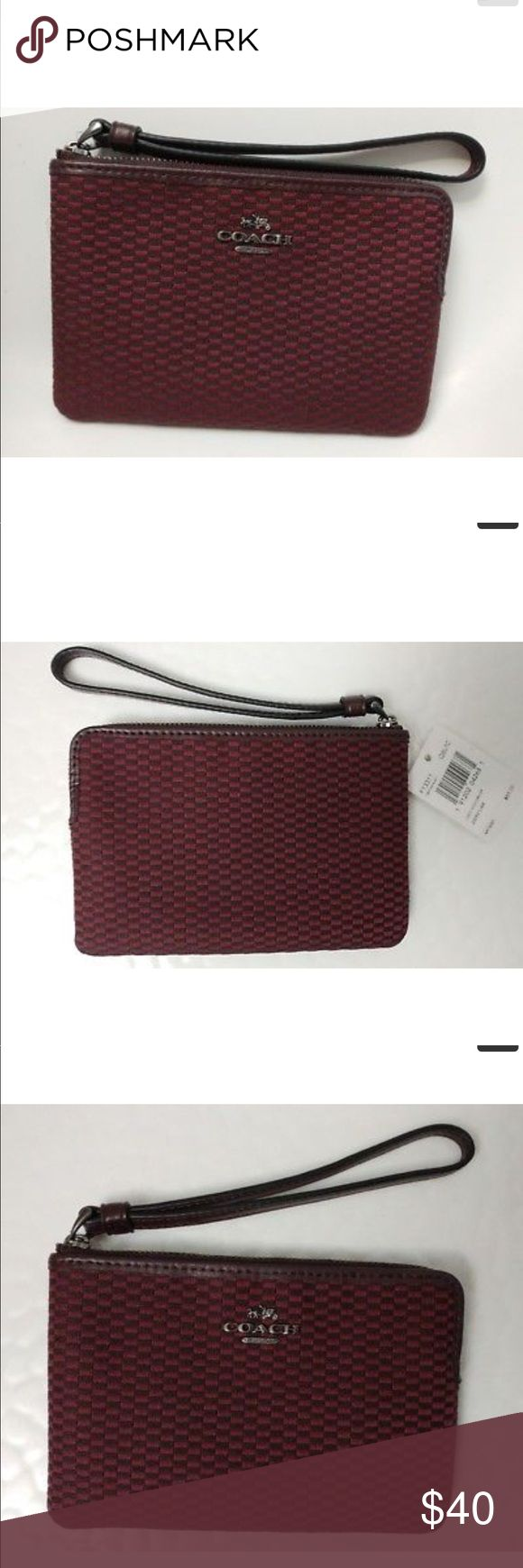 NWT Coach Corner Zip Wristlet Legacy Jacquard NWT Coach Zip Wristlet Legacy Jacquard Style F13311. Zip top closure with fabric lining. Two credit card slots. Wrist strap attached. Fits an IPhone or Android. Color black antique nickel/oxblood. Coach Bags Clutches & Wristlets