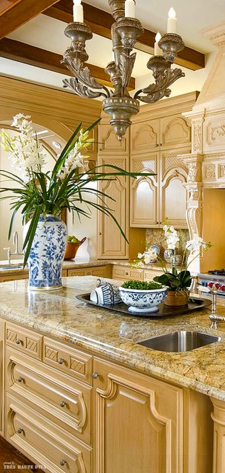 Classic French kitchen. Beautiful. Would love the cabinets in a creamy off white and a daintier chandelier