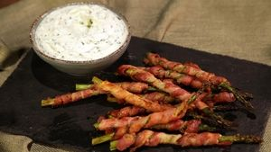 Bacon-Wrapped Asparagus with Herbed Goat Cheese Dip Recipe | The Chew.  Saving for the dip recipe.