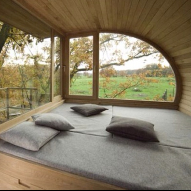 bedroom inside a tree house i love all the windows