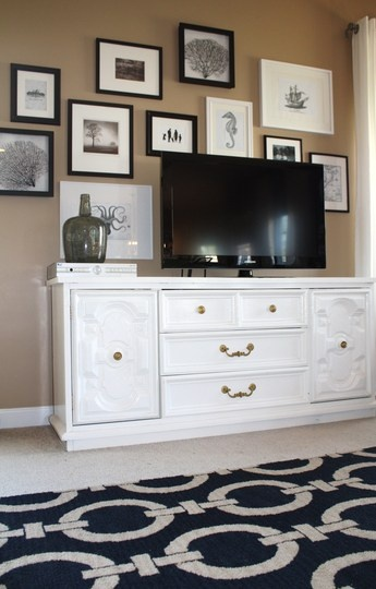 I love the idea of pictures around the TV.  Our TV is mounted, which makes this easier, I think.  We also have almost the same dresser deal (it needs to be painted white).  And I want that rug!!!