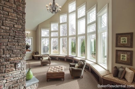 A stone hearth and a wall of soaring windows define this room. The Villages at Timber Oak. Newly built homes from Baker Residential in Bethel, CT. #StartFreshBuyNew @New Home Source