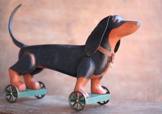 The Pull-Toy Series No. 9 - The Dachshund 17l x 5 1/4w x 10 3/4t White Pine, Brass, Steel, Pewter, Copper, Leather, Found Wood, Glass  Each piece is hand carved and constructed in a very traditional manner. The finish is interesting and complex. Each piece is a joy to handle and to examine. These are not toys for small children. These are decorative pieces. If you are interested in other custom pieces. please contact me.