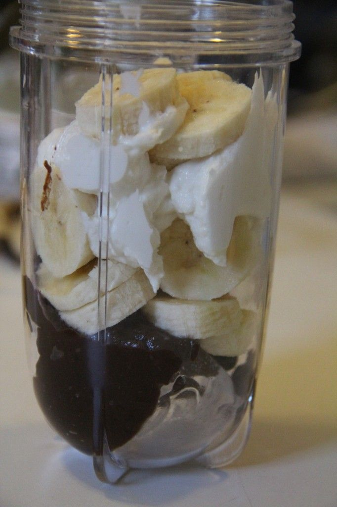 Nutella Banana Smoothie -1 cup nonfat vanilla yogurt -1/3 cup Nutella -1 banana, sliced -1 cup ice ~~Throw all said ingredients into your Magic Bullet and blend until your desired consistency has been reached.