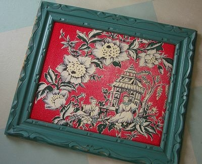 I love this project.  The artist framed the beautiful red fabric.