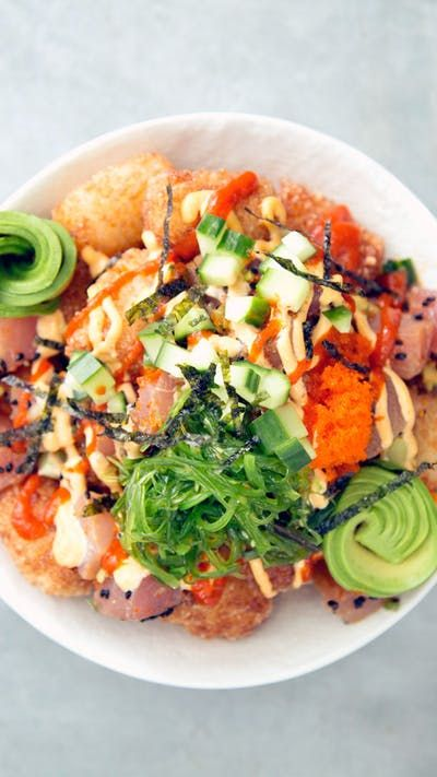 Spicy tuna crispy rice meets tater tots, meets poké bowl, to create your newest sushi obsession.