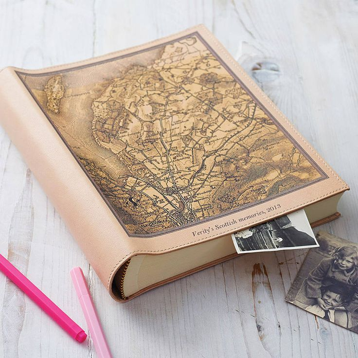 personalised map leather photo album by atlas & i | notonthehighstreet.com  I'd love one of these after Iv done all my travelling so i can put all my photos inside