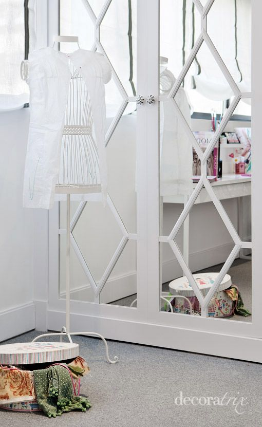 Dress up mirror closet doors with patterns made out of painted wood.