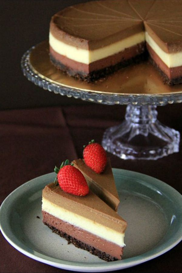 The creamiest, richest recipe for Triple Layer Cheesecake cheesecake you'll ever make, layered with white & dark chocolate and Kahlua.