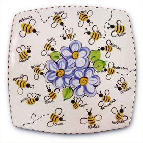 Student fingerprints turned into bees on ceramic platter. Very cool