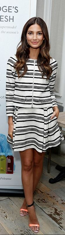 Who made Lily Aldridge's black stripe jacket, pleated white skirt, and orange ankle strap sandals