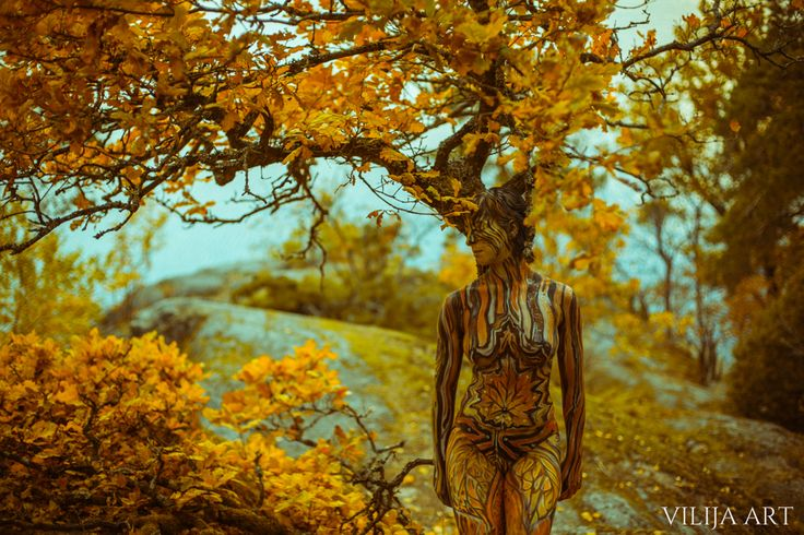 "Photography, Bodypainting – Vilija ART.  Model – Leire Mese  Magical ""Autumn"" series created by artist Vilija Vitkute by using bodypainting and photography takes you to colorful Alby woods in Sweden."