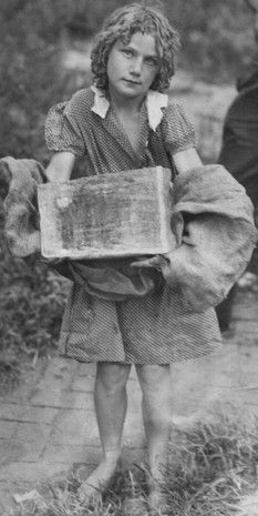 A girl carries home her block of ice with the help of a burlap sack. Penny Ice Fund 1939 Indianapolis Star file photo