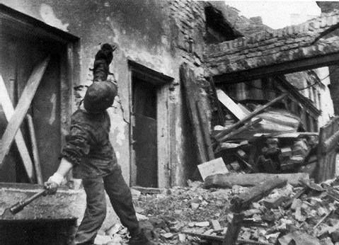 Polish resistance fighter Jerzy Siwiec throwing a German Model 24 grenade at Slepa Street in the Old Town section of Warsaw Poland August 1944.