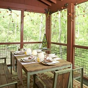 Screened in porch décor…love the rustic table