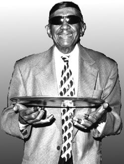 """Eldridge """"Eddie"""" Gabriel (3/23/1910-2005) He began his career at Pat O'Brien's in 1938, 5 yrs after the bar opened. Strangely, he just walked in and started waiting on tables. No one had officially hired him, but they knew he was special. Shortly, he was up on stage tapping his aluminum tray with coins on top to the beat of the piano players. That was the beginning of his long 67 year musical career in the Piano Lounge at Pat O'Brien's. He never missed a day of work. Sadly drowned in Katrina"""