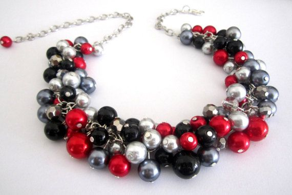Red Bridesmaids Pearl Necklace by SLDesignsHBJ on Etsy #weddings #integritytt #etsyhmw A gorgeous cluster of red, black and gray pearls together with sparkling, silver faceted crystal beads. A perfect addition to your wedding attire, special occasion or evening out.