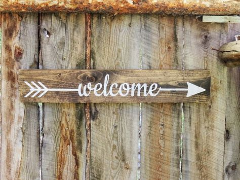 Hello and thanks for stopping by Bearly Makin It -n- Montana !!! Rustic wood arrow sign that says  Welcome  perfect your rustic home or cabin décor. Measurements: 24 L x 4 1/8 W Wood: Pine ~ Wood has been sanded by hand, stained, and then hand painted. The sign is then lightly distressed.  Color: Snow Additional information ~ Each one of our signs are coated with a sealant and a hanger is attached to the back.  Please note ~ Actual colors may vary slightly from those displayed on the…
