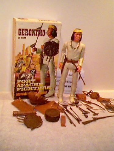 """Geronimo was an official addition to the FAF collection. Geronimo was 12"""" tall, had a white to off white poly-plastic body and had the same poly-plastic and vinyl accessories as Chief Cherokee with one exception. Geronimo was the only Indian that had a Yellow headband added. Geronimo can be identified as an Indian with straight long hair with no braids."""
