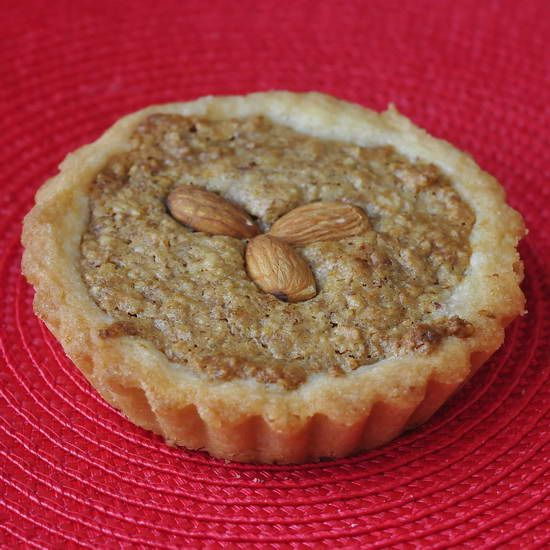 Almond Spice Cookie  Tarts - a soft sugar cookie shell holds a fragrant spice and almond filling. Terrific served with a scoop of vanilla Ice cream.
