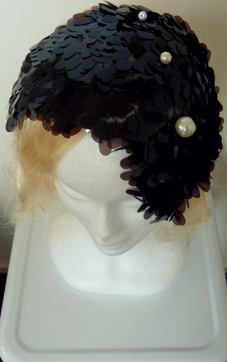 Black cocktail hat/spring race hat black Black teardop shaped sequins cover this headpiece. Handblocked with three pearls dotting the midline.