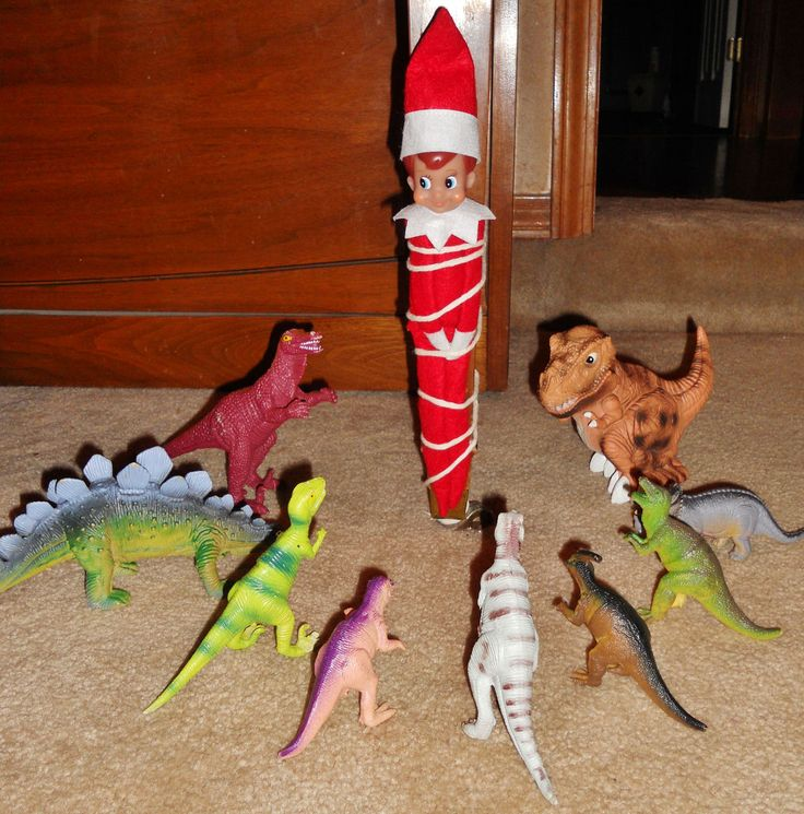 Elf Tied Up by Dinos This poor elf got into some trouble last night!  We woke up to find him all tied up and surrounded by our son's d...