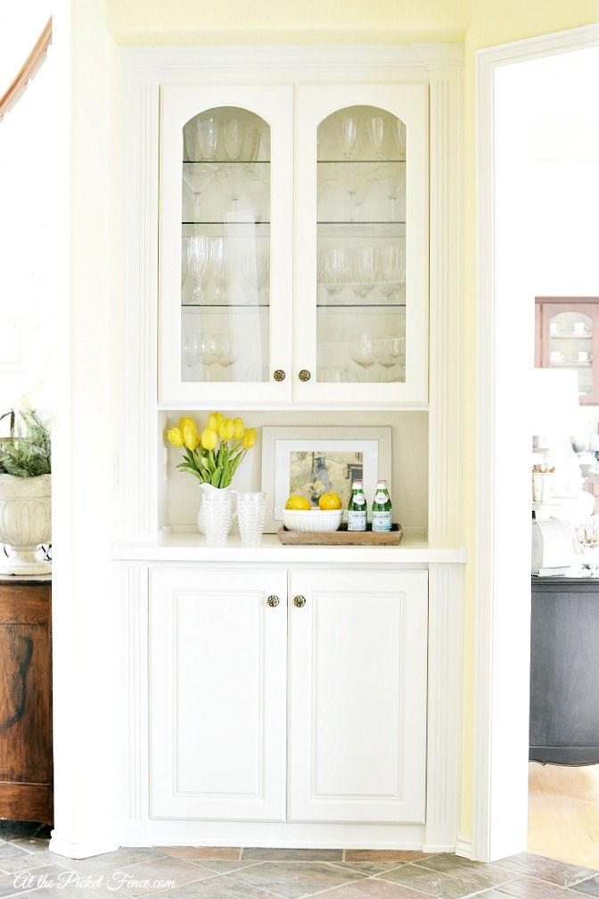 The color of paint used is called 'Neutral Ground' by Sherwin Williams. in china cabinet makeover atthepicketfence.com