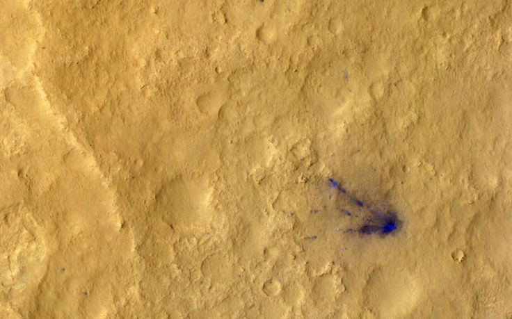 After the sky crane delivered Curiosity to Mars on August 5, it flew away and fell to the surface. Possible multiple impacts from that collision are revealed in blue in this enhanced-colour view taken by the High-Resolution Imaging Science Experiment (HiRISE) camera on NASA's Mars Reconnaissance Orbiter. The impact sites are darker because the lighter, reddish top layer of soil was disturbed, revealing darker basaltic sands underneath. [Picture: NASA/JPL-CALTECH/UNIV. OF ARIZONA/AFP/Getty]