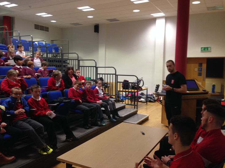 Pupils from Ysgol Rhos Helyg & Queensferry CP School taking part in our role play press conference interviewing Connah's Quay players at Deeside College.