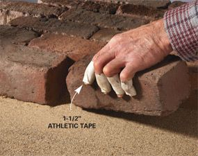 When you're working with bricks or stone, wrap your fingers with athletic tape to protect your fingers, plus it gives more dexterity than gloves