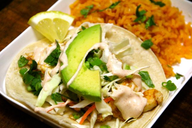Alaskan Halibut Tacos -  Ingredients:  2lb halibut steaks  2t canola oil  salt  pepper  taco seasoning (your favorite or homemade)  20-24 small white corn tortillas  2c shredded cabbage  1/2c cilantro, chopped  1 bunch green onions, sliced  1 ripe avocado, sliced  salsa  lemon or lime wedges  For Crema:  1/2c sour cream (I use lite)  2-3T milk, for thinning  juice of half a lime  1-2t hot sauce, depending on how spicy you like it (like Tapatio)  1t taco seasoning  salt to taste