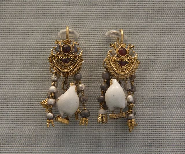 Earrings with the pendant cocks in white enamel, Etruscan, 300-200BC British Museum