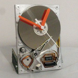 Hard Drive Clock - Made from a recycled 3.5 inch computer hard drive that has been transformed into a working desk