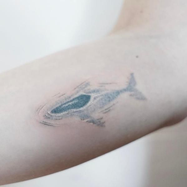 Amazing stick and poke whale tattoo by Tattooist Baka.