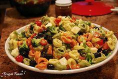 Tortellinin Salad  Cold cheese tortellini, broccoli, black olives, grape tomatoes, mozarella chunks & a creamy basil vinaigrette