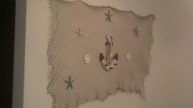 My beach inspired home decor Hobby lobby fishnetseashells and anchor from big lots Around 20