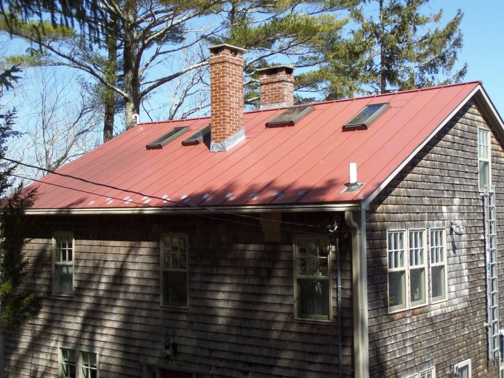 A Beautiful, Red Color Standing Seam Metal Roof With Skylights On A  Slightly Aged Cedar