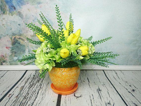 Spring floral arrangement yellow tulip green hydrangea orange