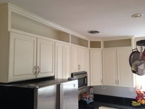 Cabinets an eye and extensions on pinterest for Adding height to kitchen cabinets