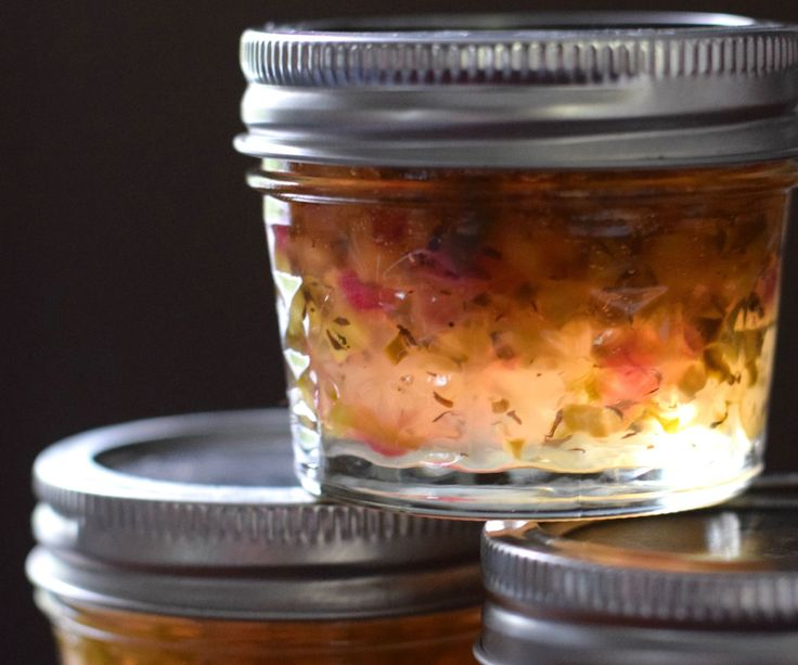 An unusual jelly with incredible taste and lots of uses! Banana Pepper & Basil Jelly is sweet and tart, with chunks of peppers and red onion, and a hint of herby-ness.This is a great way to preserve the fresh peppers and basil you have growing!The gorgeous light yellow jelly with streaks of pink and flecks of yellow and green is absolutely stunning! It makes a wonderful holiday or hostess gift, and it will be the talk of any potluck or dinner party- with everyone asking for the recipe (tr...