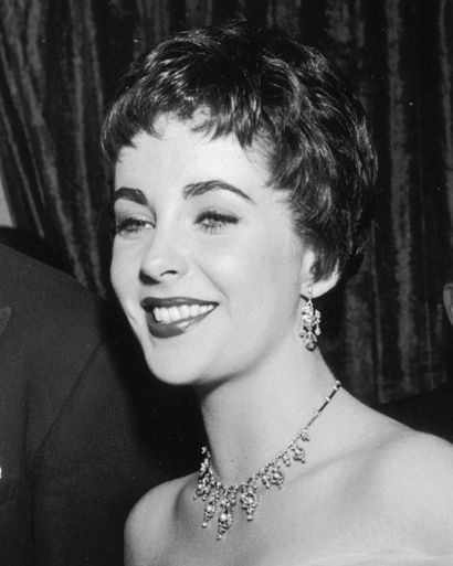 Elizabeth Taylor. Pixie cut. Dame Elizabeth Taylor with a true pixie cut and this was before Audrey Hepburn's short haircut. Halle Berry also has a true pixie cut as well.