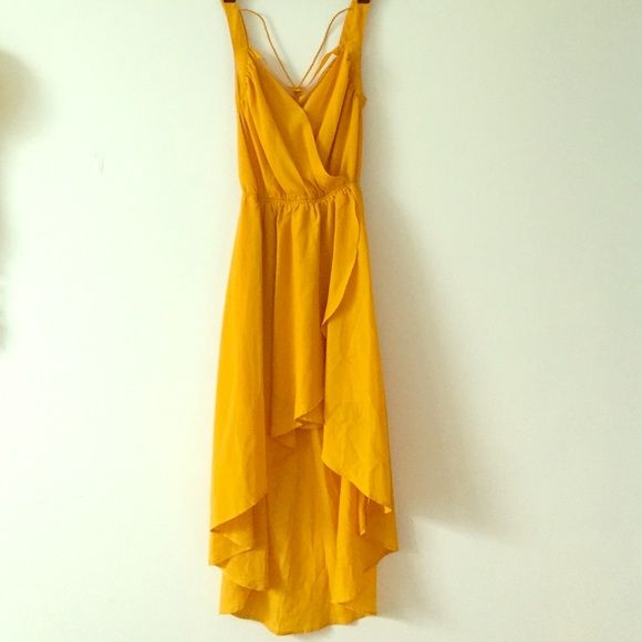 Mustard yellow dress Beautiful color, high low, very pretty cut out back, perfect for summer because it is very light Dresses High Low