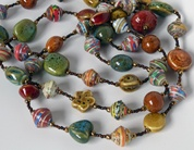 Signature Necklace made in Haiti from recycled cereal boxes by moms and dads at the Apparent Project