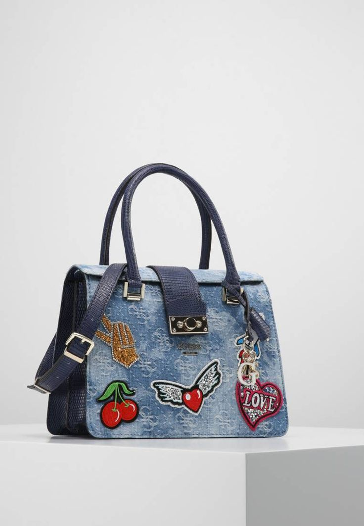 """Guess. ELIA  - Handbag - blue denim. Pattern:animal print. Fastening:Magnet. Compartments:mobile phone pocket. length:10.5 """" (Size One Size). width:4.5 """" (Size One Size). Lining:Cotton,Polyester. carrying handle:5.0 """" (Size One Size)...."""